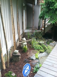 asian themed entry bed alcove pond bamboo zen rocks statue peaceful house entry