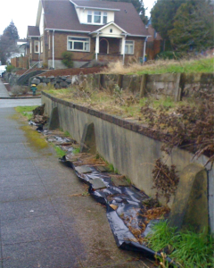 seattle older vintage home aging concrete retaining wall replacement
