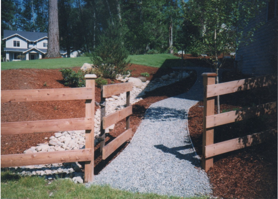 Dry River Bed Installation Improves Drainage on Woodinville Estate Property path bark crushed rock