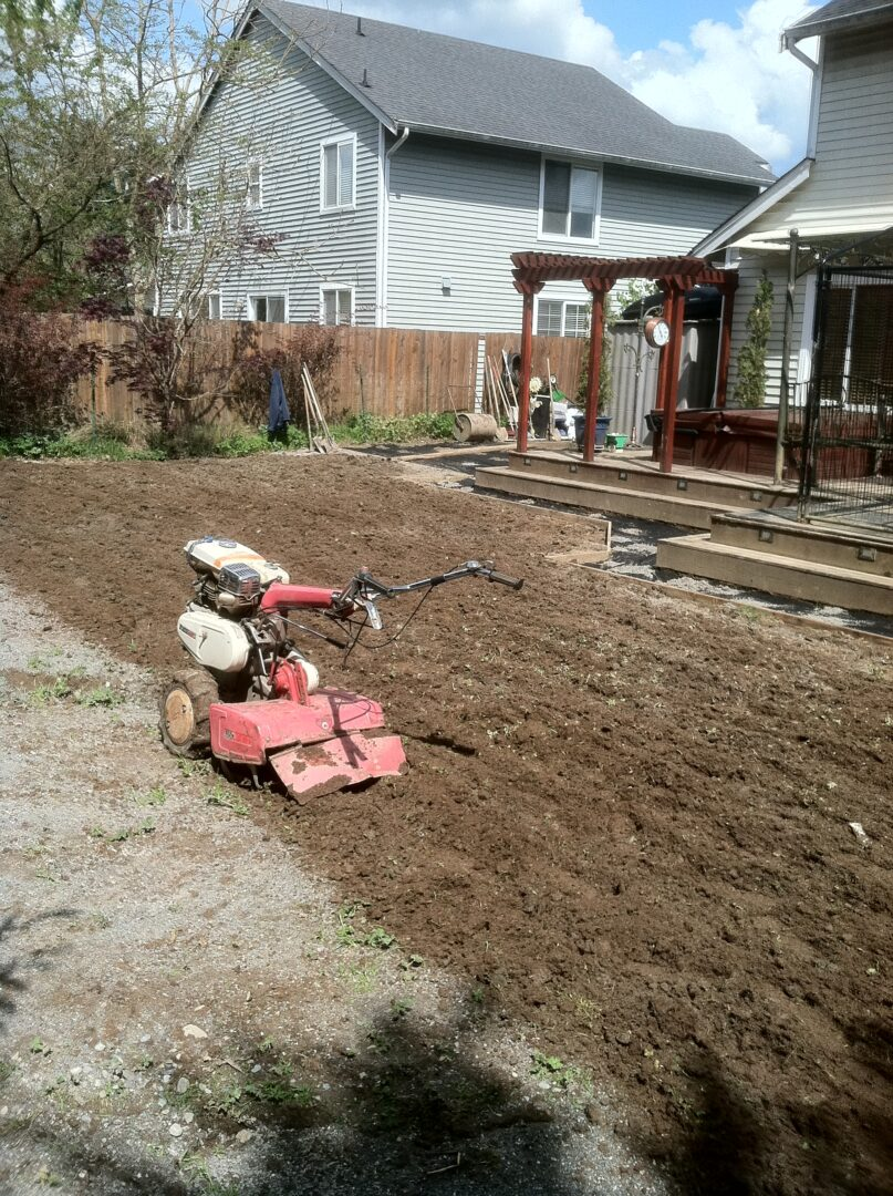New sand and compost tilled into existing clay soil