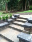 beautiful cement stairs with accent on two tiered residential patio for entertaining by mackay landscape services seattle eastside