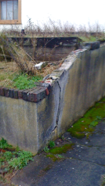 seattle older vintage home aging concrete cracked retaining wall replacement before