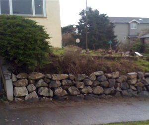 seattle older vintage home aging concrete retaining wall replacement new rockery