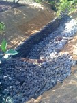 sandbag retaining wall rebuild stream bed creek renovation restoration woodinville commercial property landscape improvement water flow